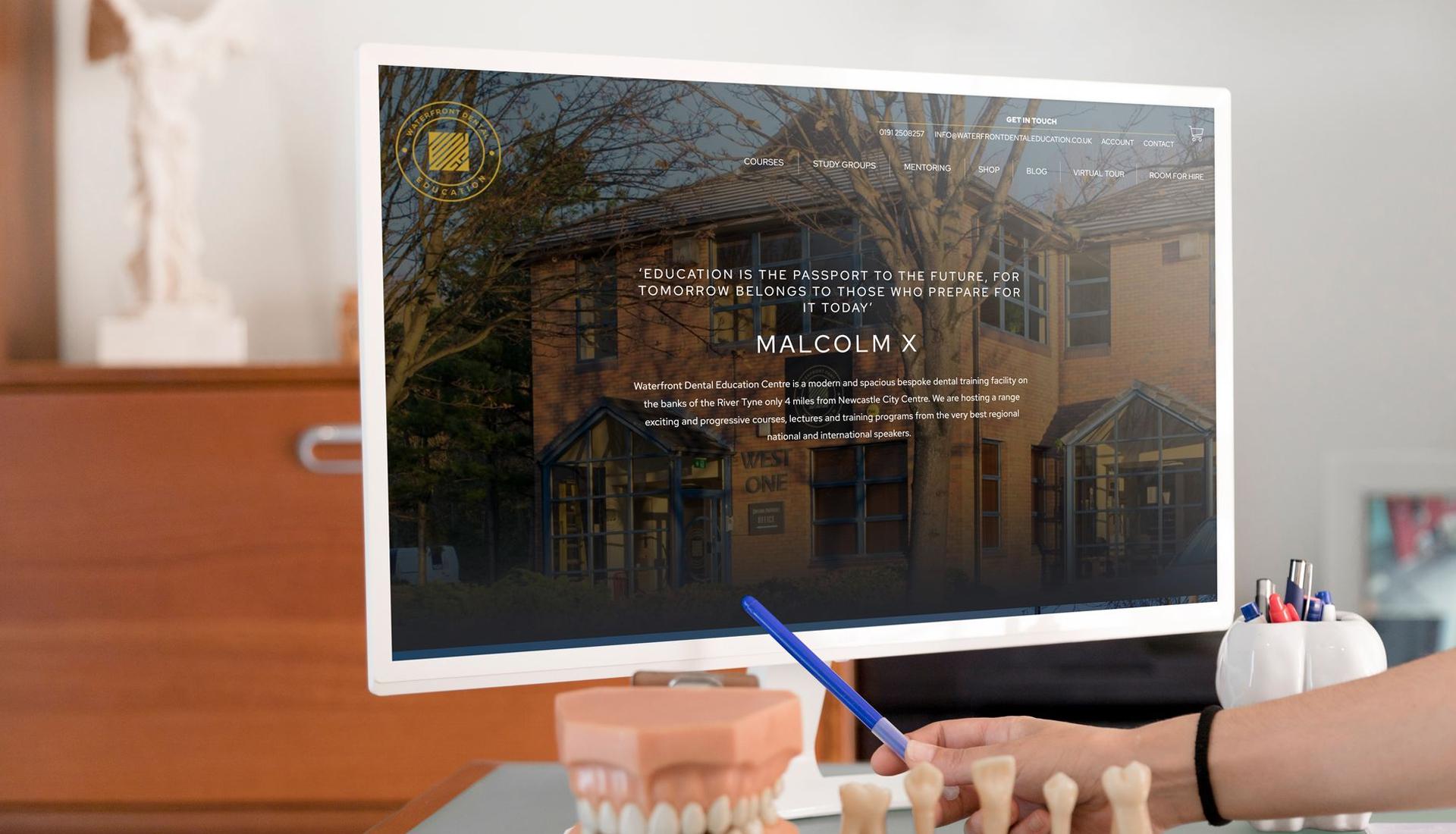 Waterfront Dental Education's website displayed on a desktop computer