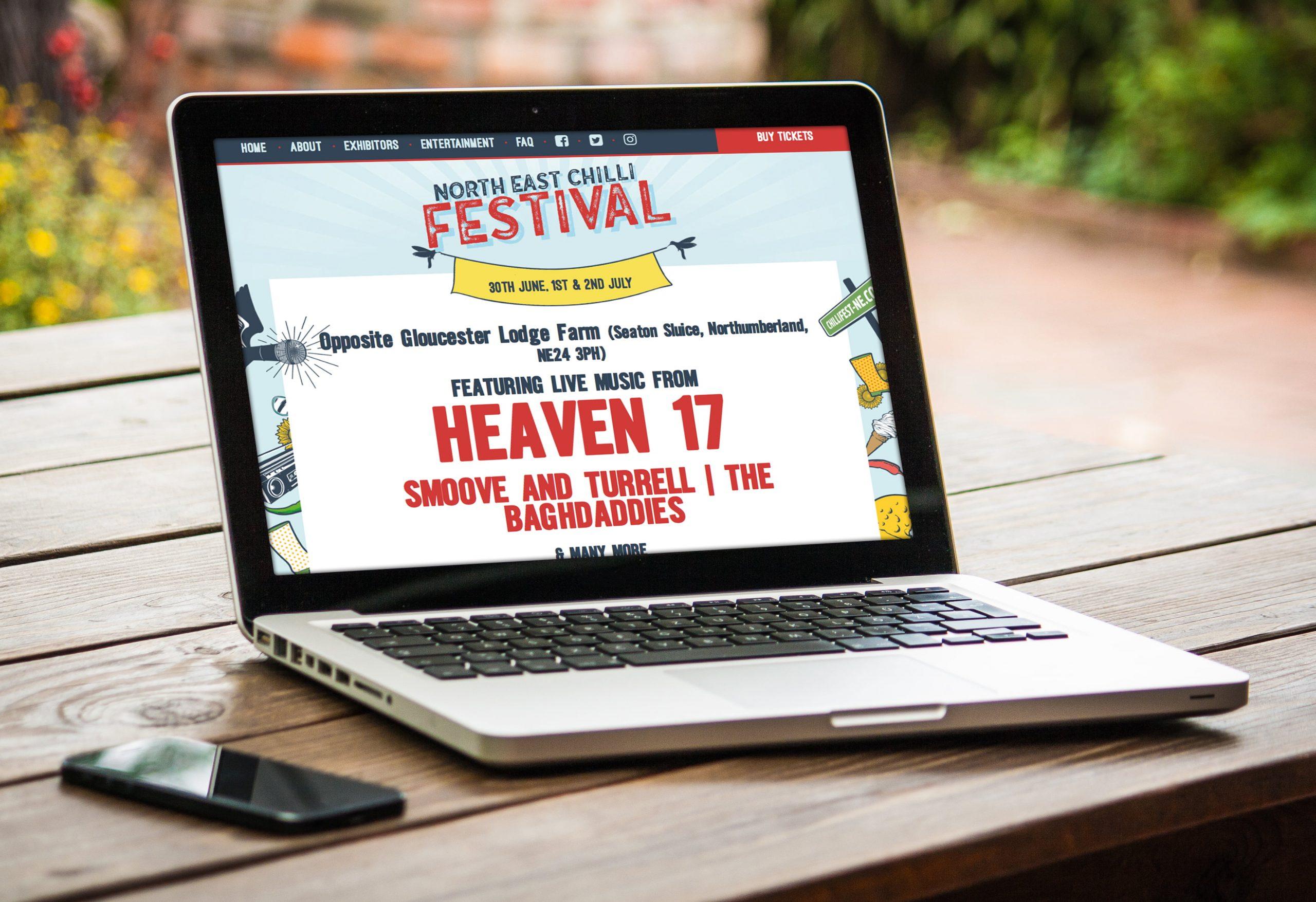 North East Chilli Festival website displayed on laptop