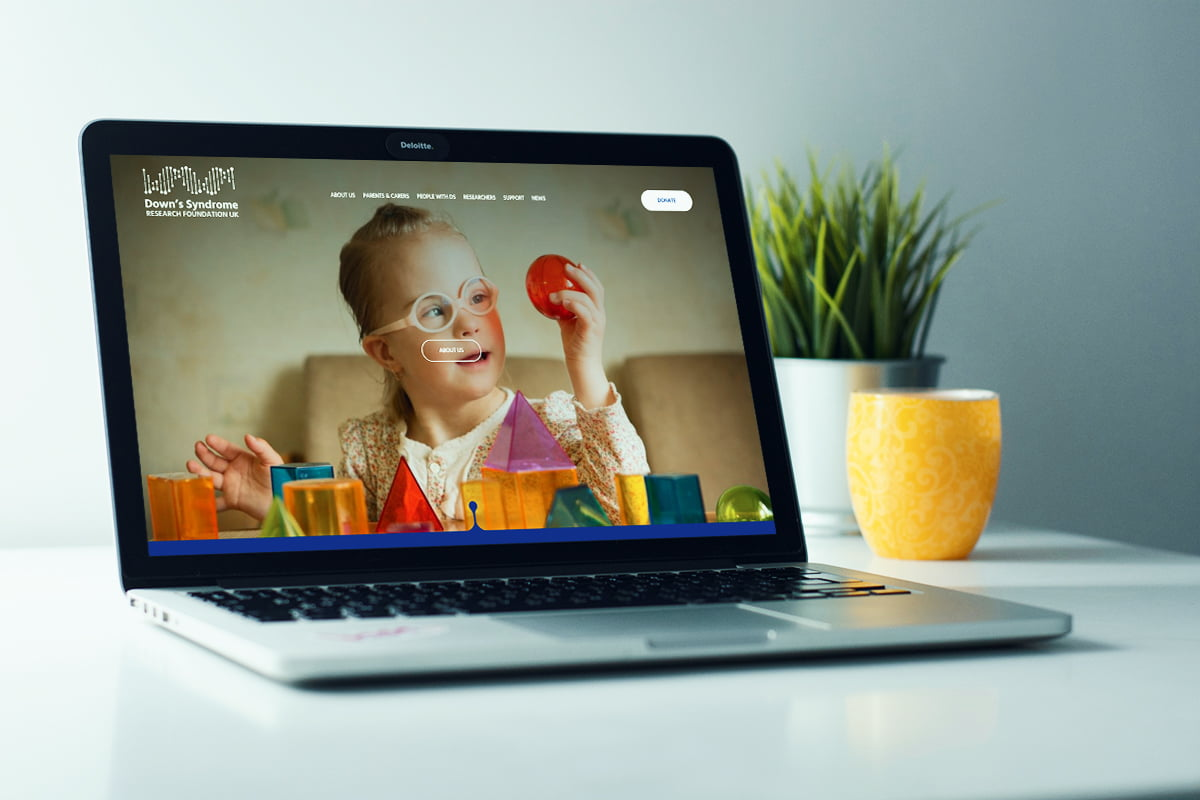 Down Syndrome Research Foundation website displayed on laptop computer