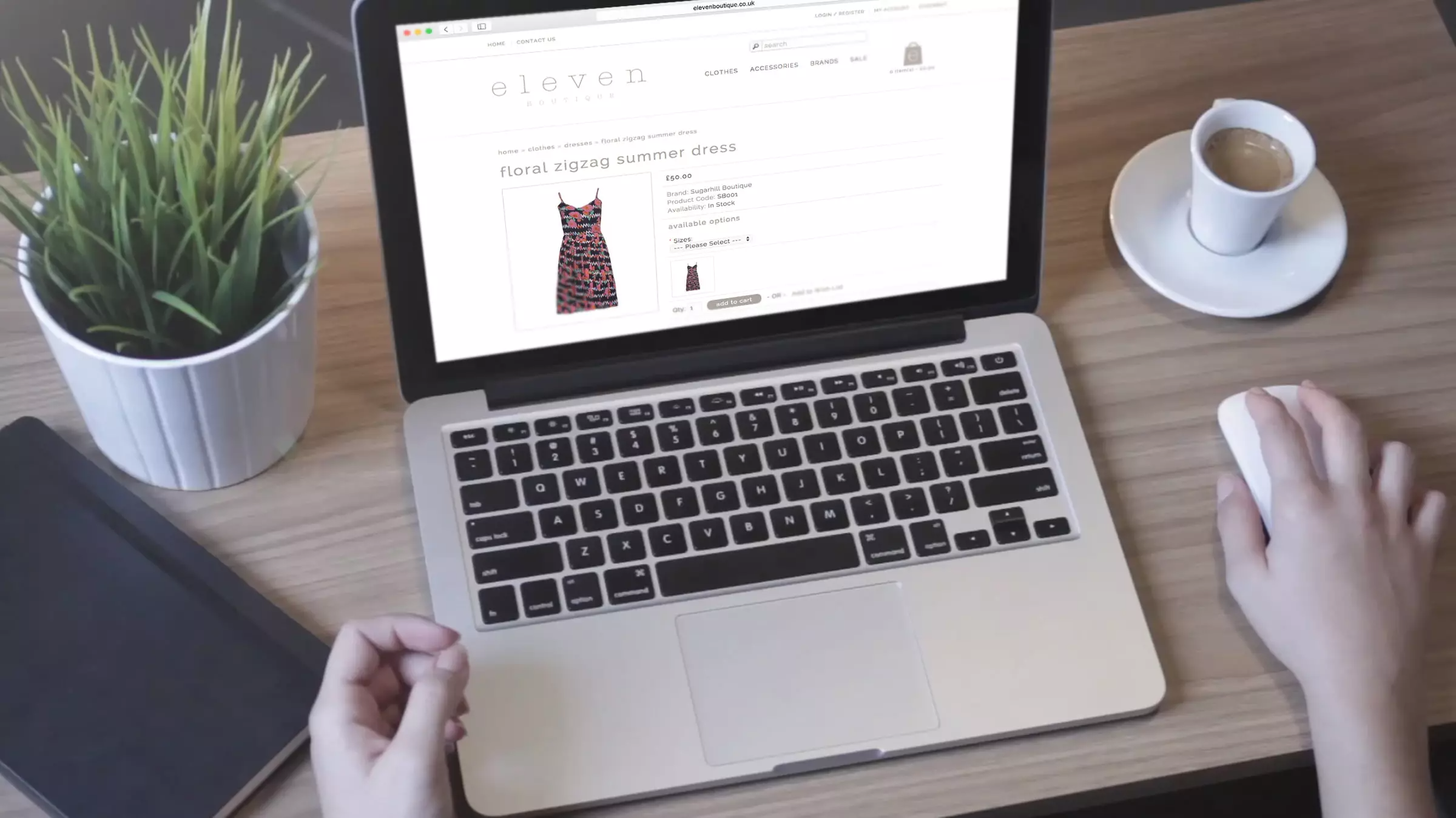 Eleven Boutique website being browsed by person on a laptop