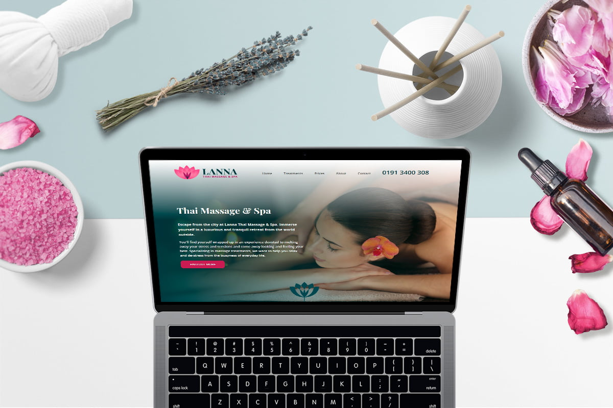 Lanna Thai Massage website displayed on laptop