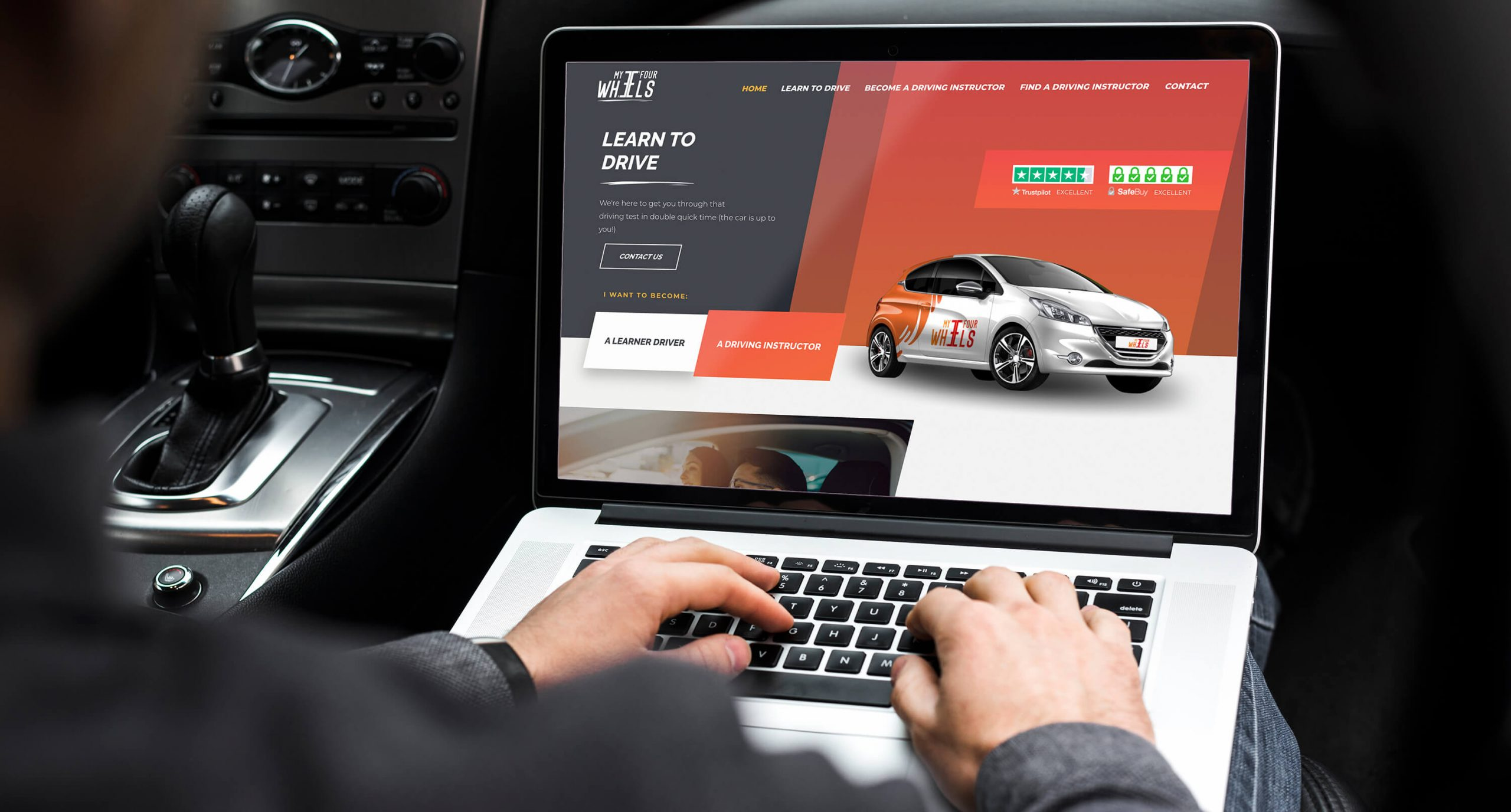 My Four Wheels website displayed on a laptop screen