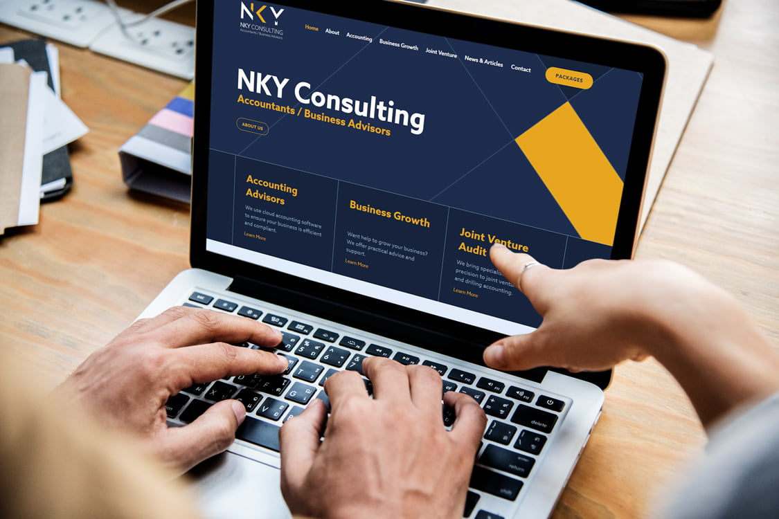 NKY Consulting website being viewed by two people on one laptop
