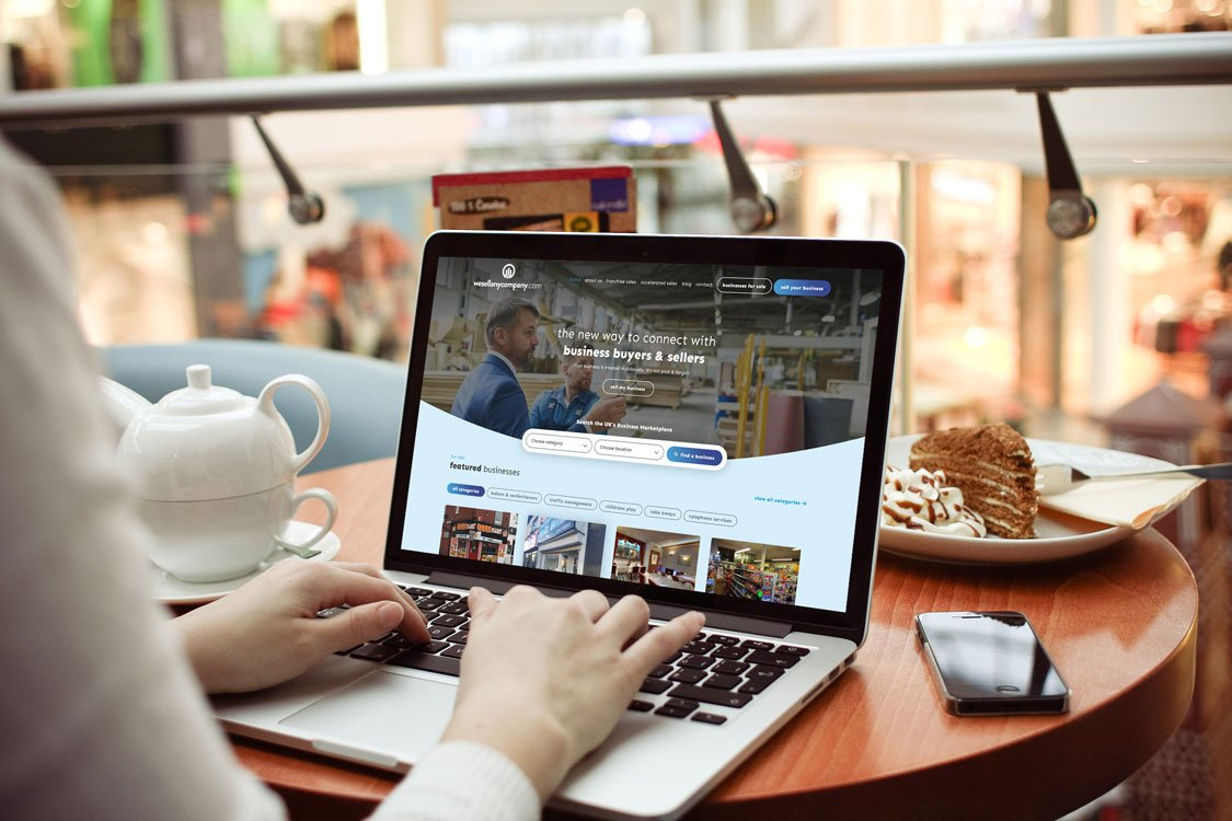 We Sell Any Company website being viewed on a laptop by a person