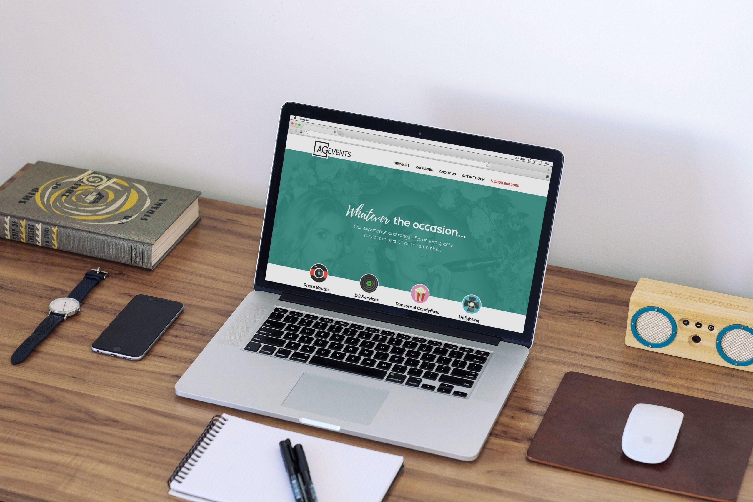AG Events website displayed on laptop