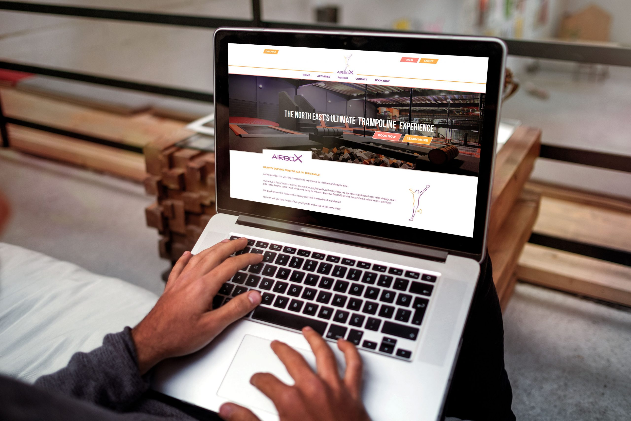 Airbox website being viewed by person on laptop