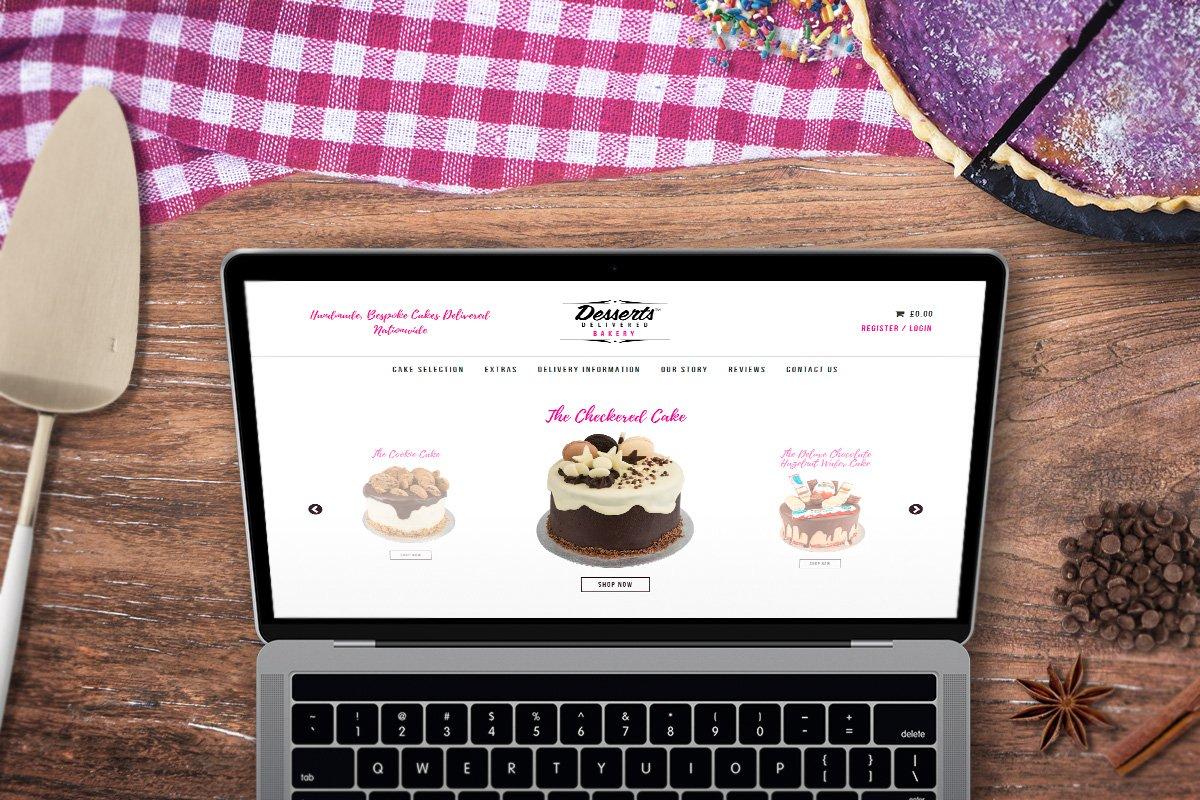 Desserts Delivered Bakery website displayed on laptop