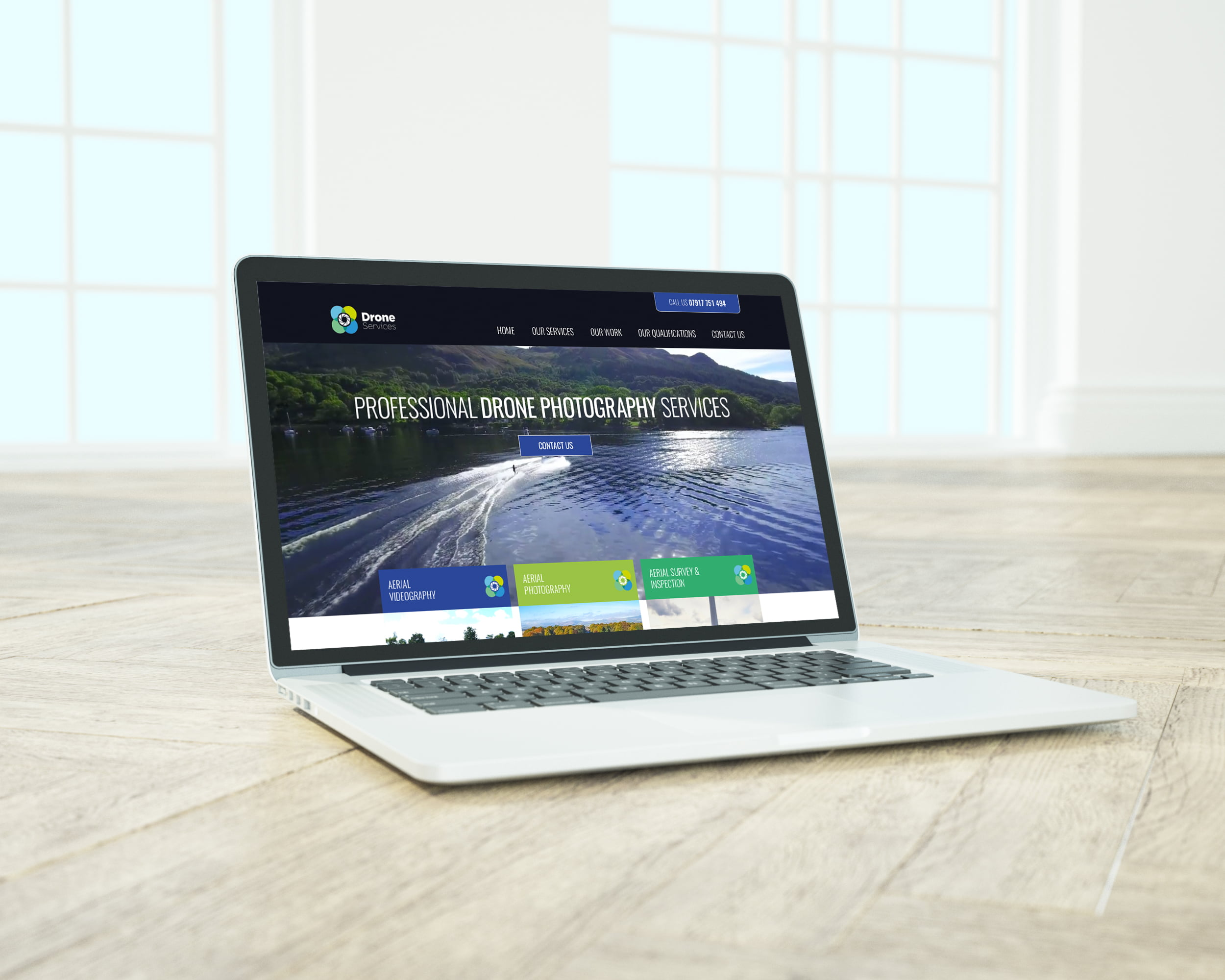 Drone Services website displayed on laptop