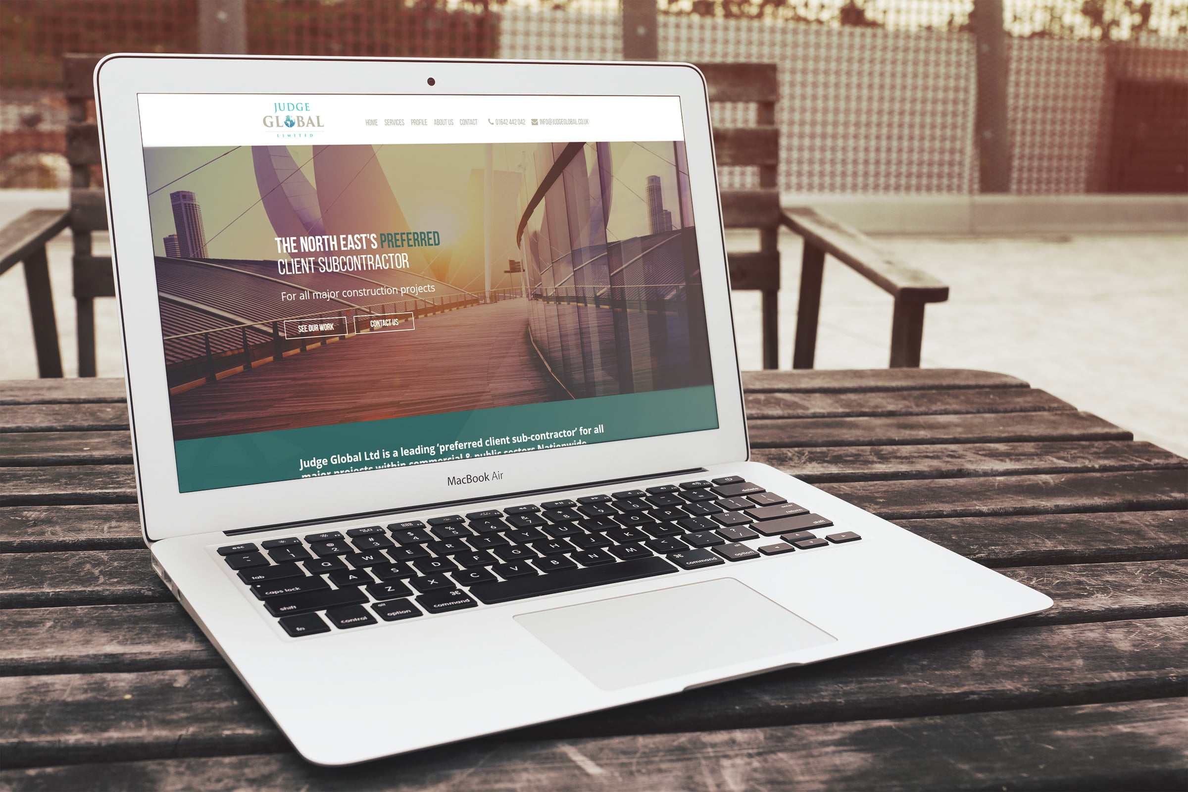 Judge Global website displayed on laptop