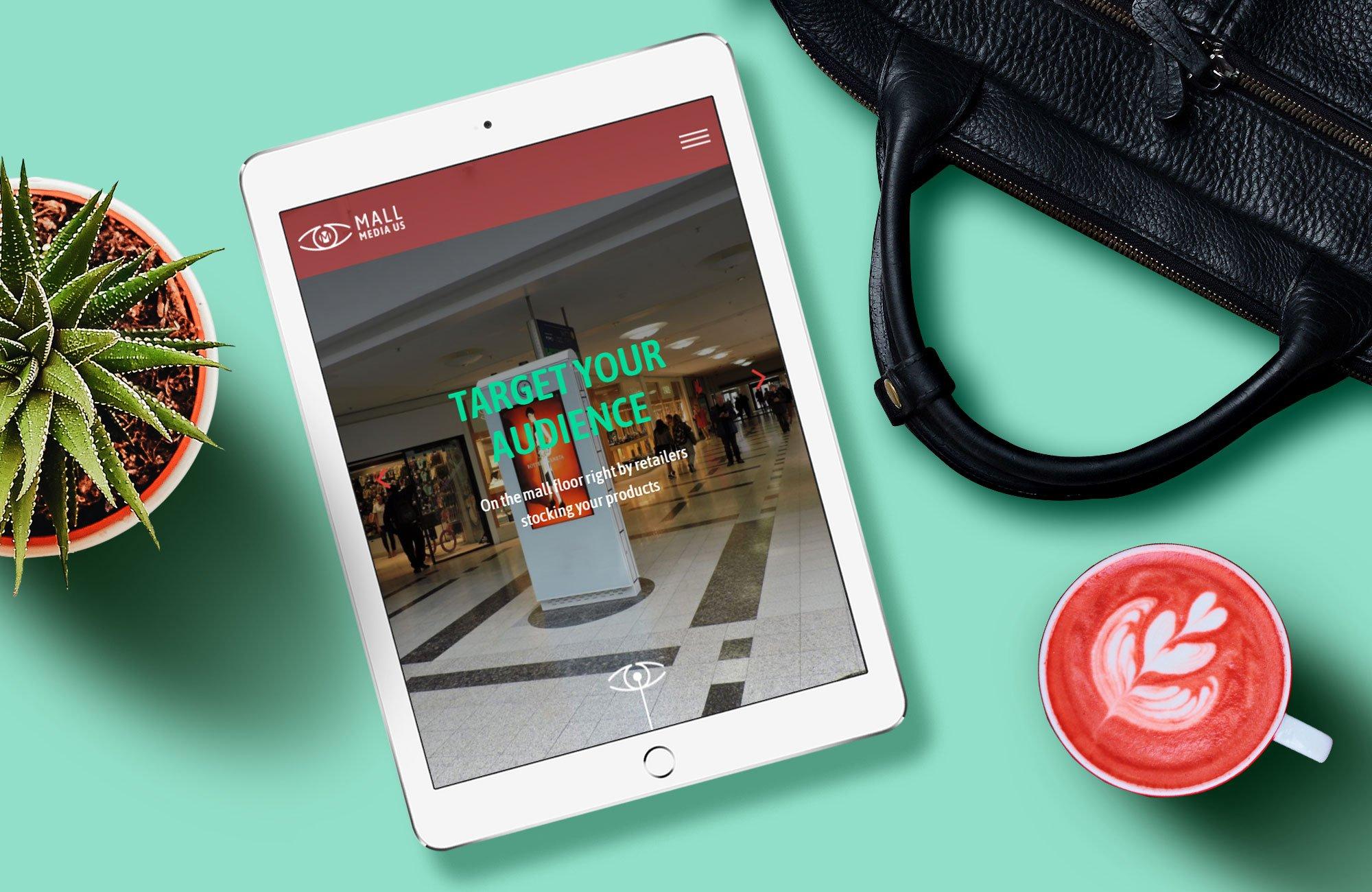 Mall Media US website displayed on tablet