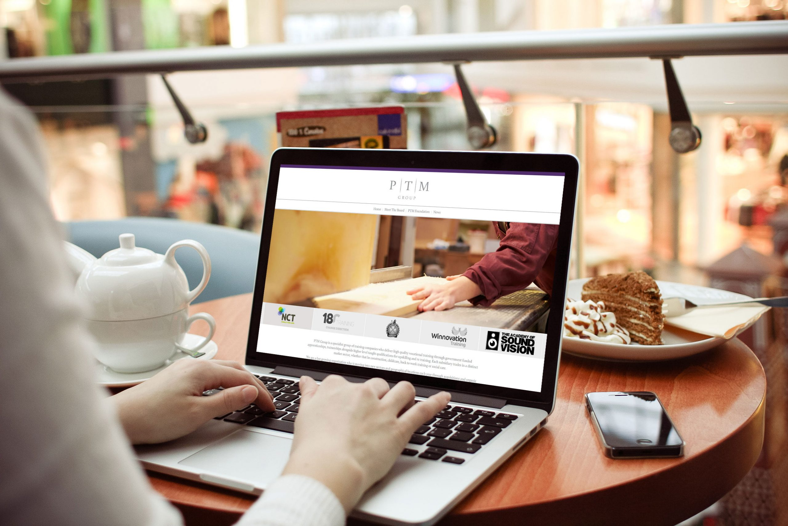 PTM Group website being viewed by person on laptop