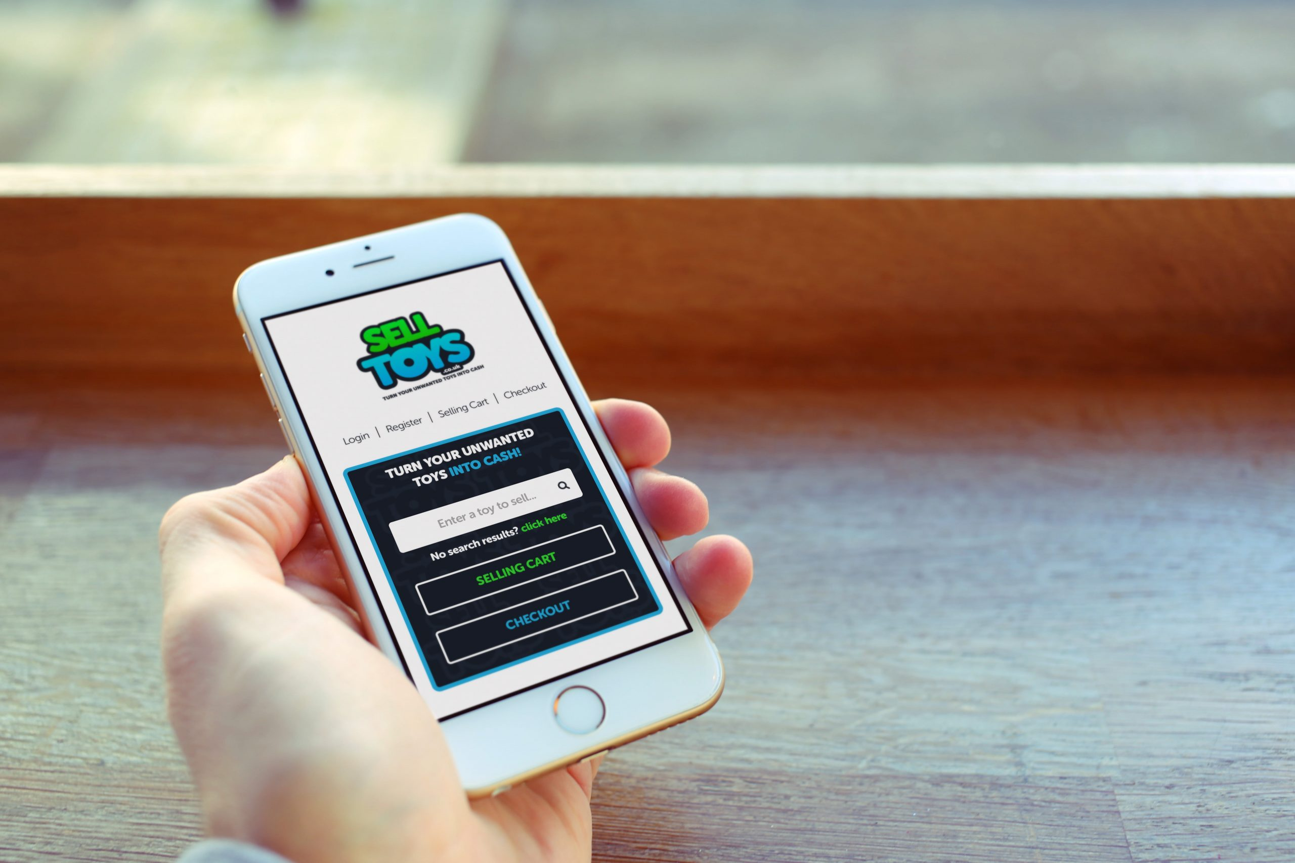 Sell Toys website being viewed by person on mobile