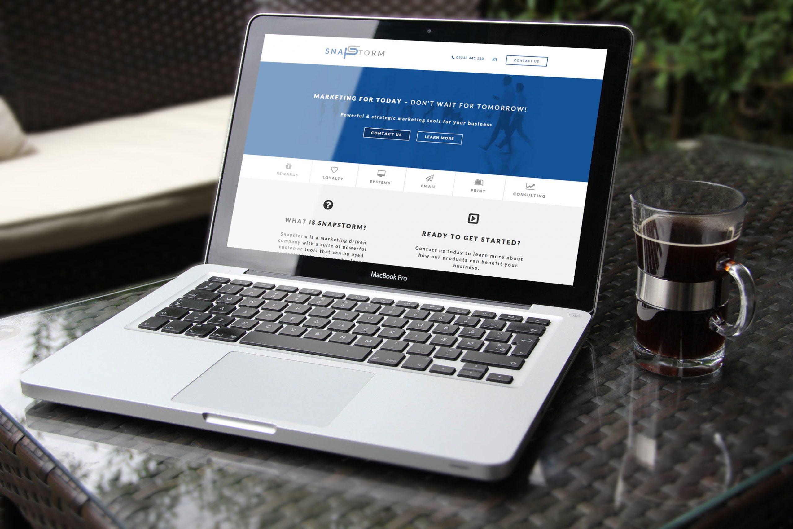 Snapstorm website displayed on laptop